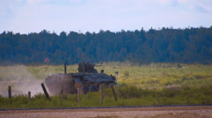 Btr-82a moving on the range on military exercises and firing a machine gun Stock Footage