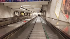 HELSINKI, UUSIMAA, FINLAND,  Riding the escalator down towards the su Stock Footage