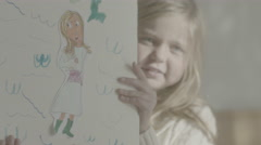 Two young girls explain the significance of their latest crayon-mural. Stock Footage