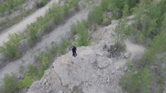 Businessman stands on the mountain in his career Stock Footage