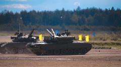 "Four tanks T-90 are dancing on ""tank biathlon"" Stock Footage"