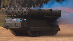 Self-propelled rocket launcher moving on the range on military exercises Stock Footage