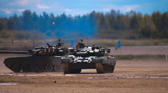 "Four tanks T-90 are dancing on ""tank biathlon"" Stock Footage"