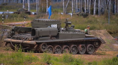 Tracked armored military equipment is at rest at the river Stock Footage