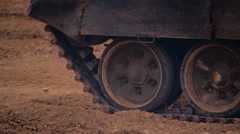 Tracked armored military vehicles driving on a dusty road military range Stock Footage