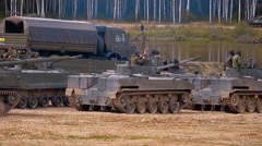 Column of armored military vehicles and soldiers on the board Stock Footage