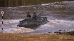 Armored military BMP and soldiers on the board are cross the river Stock Footage