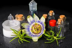 Beautiful spa setting of blue passiflora flower, cosmetic salt mortar and fra Stock Photos