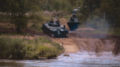 Armored military BMP and soldiers on the board, successful cross the river Stock Footage