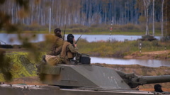 Armored military Sprut-SD and soldiers on the board are monitoring the situation Stock Footage