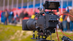 Cameraman shoots with a tripod on professional camera current news Stock Footage