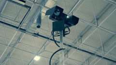 Military special video surveillance camera on a high telescopic pole in hangar Stock Footage