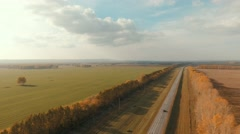 Aerial shot of a rural road. Country road and field Stock Footage