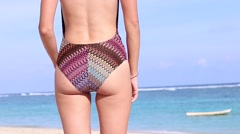 Rear view sexy beautiful young woman on the beach, tropical ocean shore. Bali Stock Footage