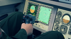 Pilot by joystick controls the helicopter, airplane or other flying means Stock Footage