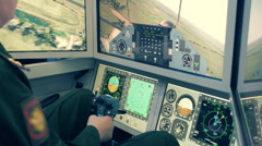 On flight simulator pilot by joystick controls the flying helicopter Stock Footage