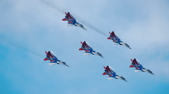 "Aerobatic team ""Swifts"" performs aerobatics on a background of blue sky Stock Footage"