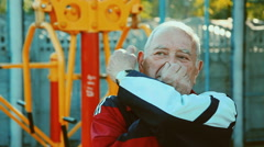 An elderly man performing exercises to coordinate movement Stock Footage