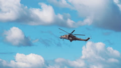 Attack helicopter Mi-24 flying on a background of clouds. Included audio Stock Footage