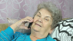 Aged woman talking with daughter on cellphone Stock Footage