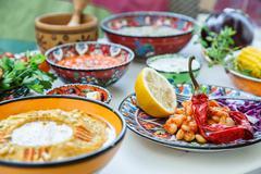 Mediterranean traditional meze: hummus, babaganoush, harissa, tzatziki on white Stock Photos