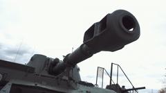 Muzzle brake compensator of tank gun on background of sky Stock Footage
