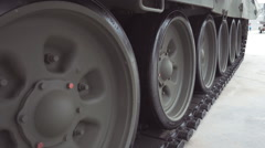 Track and rollers of military machine Stock Footage