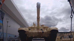 The new T-90 tank in yellow color camouflage on the car platform, ready to ship  Stock Footage