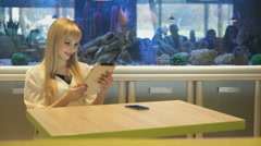 Model sitting in the background the aquarium Stock Footage