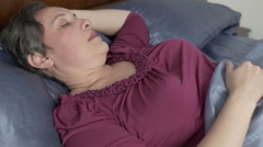Woman Sleeping On Her Back Dolly Left Stock Footage