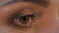 Make-up artist applying eyelash makeup to model's eye. Close up view Stock Footage