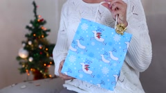 Young Girl Uses Hand Gives Gets Gift, Holds Present Paper Bag With Deers Pulls Stock Footage