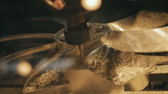 Milling machine works on the program and makes the fan from brass Stock Footage