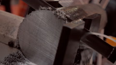 Saw cuts off part of the thick metal billet and cooled by coolant Stock Footage
