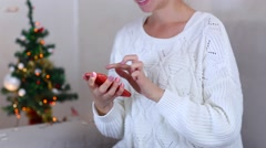 Young Girl Uses Hand Presses Phone Screen on Bokeh Xmas Eve Lights New Year Stock Footage