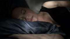 Woman Sleeping On Her Side Dolly Left Close Stock Footage