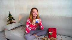 Young Girl Portrait Smile to Camera, Look Drink Tea Coffee Christmas Tree Bokeh Stock Footage