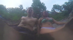 Portrait Of Couple In Natural Hot Spring, Shot From Underwater Stock Footage