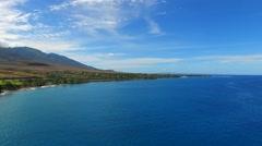 Aerial approach, sideways, to tropical island, Maui Stock Footage