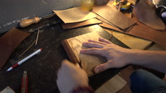 Leather Factory Manufacture Handmade Notebook - close up Hands work Stock Footage