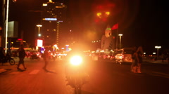 Motorcycle Drives along Lit Street with Bright Head-light Stock Footage