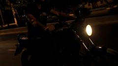Closeup Guy in Helmet Speeds on Motorcycle along Asphalt Road Stock Footage