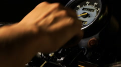 Closeup Guy Hand Switches on Motorcycle Throttle on Board Stock Footage