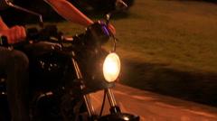 Closeup Motorcycle Speeds along Asphalt Road Barrier Stock Footage