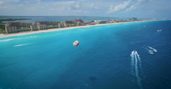Cancun parasailing along the crystal blue waters of the hotel zone. 4K UHD. Stock Footage