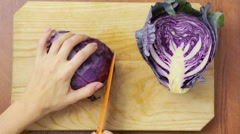 Female hands chopped cabbage on wooden board, close-up. top view Stock Footage