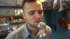 Young Man In Studio Sings Into Microphone Stock Footage