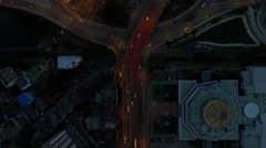 Aerial top view moving up scene over roundabout traffic circle with car moving Stock Footage