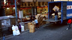 Local laborers unloading a truck in Hong Kong's commercial district Stock Footage
