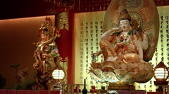 Assorted sculptures of Chinese deities inside a temple in Singapore Stock Footage